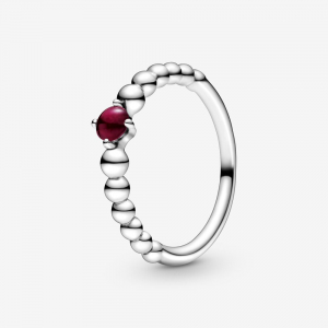 Sterling silver ring with dark red crystal