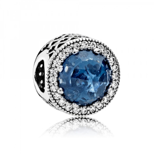 Abstract silver charm with moonlight blue crystal and clear cubic zirconia