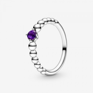 Sterling silver ring with purple crystal
