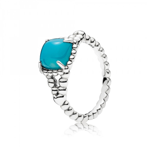 Silver ring with scuba blue crystal