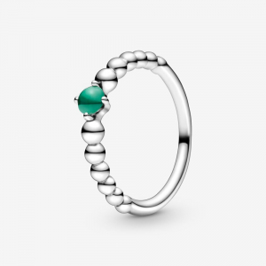 Sterling silver ring with rainforest green crystal