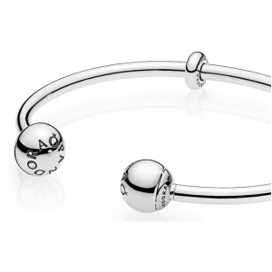 Silver open bangle with silicone stoppers and interchangeable end caps