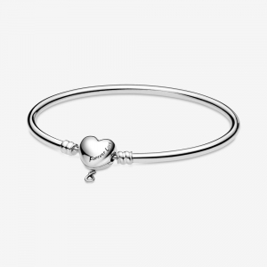 Sterling silver bangle with heart clasp