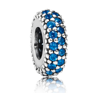 Abstract silver spacer with blue crystals